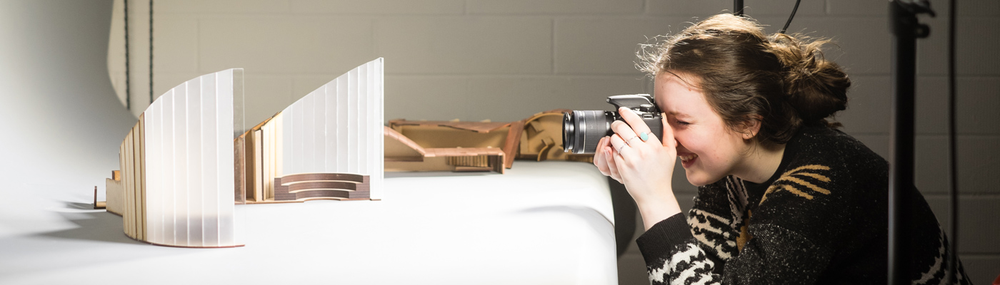 Architecture student photographing model