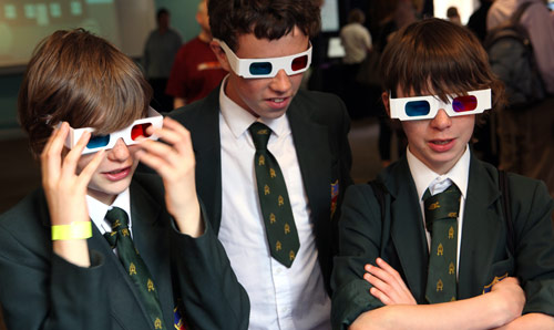 School pupils on campus wearing 3D glasses.