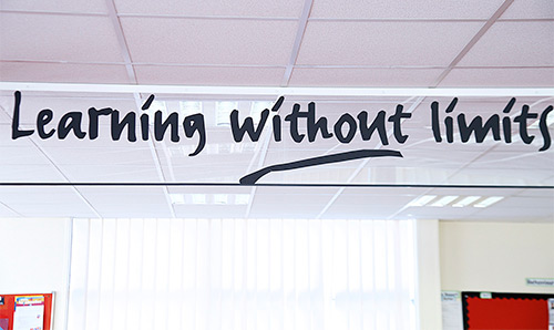 Sign in a building lobby which says 'Learning without Limits'